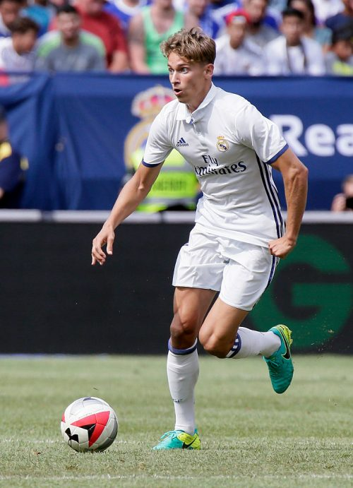 ANN ARBOR, MI - JULY 30:  Martin Odegaard #26 of Real Madrid brings the ball up field against Chelsea at Michigan Stadium on July 30, 2016 in Ann Arbor, Michigan. (Photo by Duane Burleson/Getty Images)
