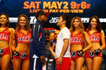 LAS VEGAS, NV - MAY 01:  Floyd Mayweather Jr. (L) and Manny Pacquiao face off during their official weigh-in on May 1, 2015 at MGM Grand Garden Arena in Las Vegas, Nevada. The two will face each other in a welterweight unification bout on May 2, 2015 in Las Vegas.  (Photo by Al Bello/Getty Images)