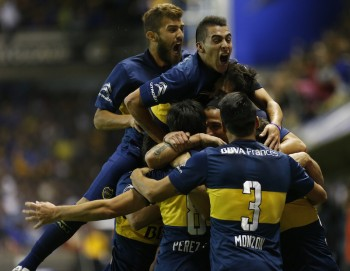 BUENOS AIRES, ARGENTINA - MAY 03:  Pablo Perez of Boca Juniors celebrates with teammates after scoring his team's second goal during a match between Boca Juniors and River Plate as part of 11th round of Torneo Primera Division 2015 at Alberto J. Armando Stadium on May 03, 2015 in Buenos Aires, Argentina. (Photo by Gabriel Rossi/LatinContent/Getty Images)
