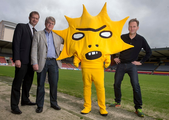 GLASGOW, SCOTLAND - JUNE 22: (L-R) Ian Maxwell, Mike Wilkins and artist David Shrigley attend a photocall as Partick Thistle announce a two-year sponsorship deal with Kingsford Capital Management at Firhill stadium on June 22, 2015 in Firhill, Glasgow, Scotland. British artist David Shrigley was commissioned to design Partick Thistle's new mascot. (Photo by Jeff Holmes/Getty Images)