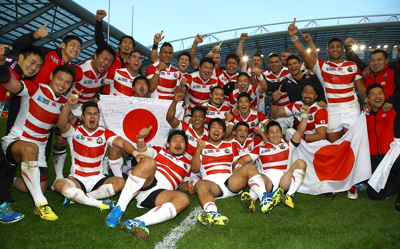 BRIGHTON, ENGLAND - SEPTEMBER 19: Japan players celebrate after the win over South Africa during the Rugby World Cup 2015 Pool B match between South Africa and Japan at Brighton Community Centre on September 19, 2015 in Brighton, England. (Photo by Steve Haag/Gallo Images/Getty Images)