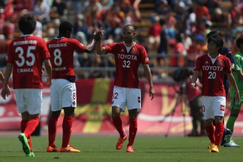 NAGOYA, JAPAN - MAY 02:  (EDITORIAL USE ONLY) Kengo Kawamata (2nd R) of Nagoya Grampus celebrates scoring his team's second goal with his teams mates during the J.League match between Nagoya Grampus and Shonan Bellmare at Mizuho Stadium on May 2, 2015 in Nagoya, Aichi, Japan.  (Photo by Kaz Photography/Getty Images)