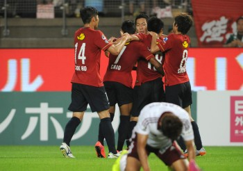 KASHIMA, JAPAN - MAY 30:  (EDITORIAL USE ONLY) Kashima Antlers players celebrate the second goal during the J.League match between Kashima Antlers and Matsumoto Yamaga at Kashima Soccer Stadium on May 30, 2015 in Kashima, Ibaraki, Japan.  (Photo by Masashi Hara/Getty Images)