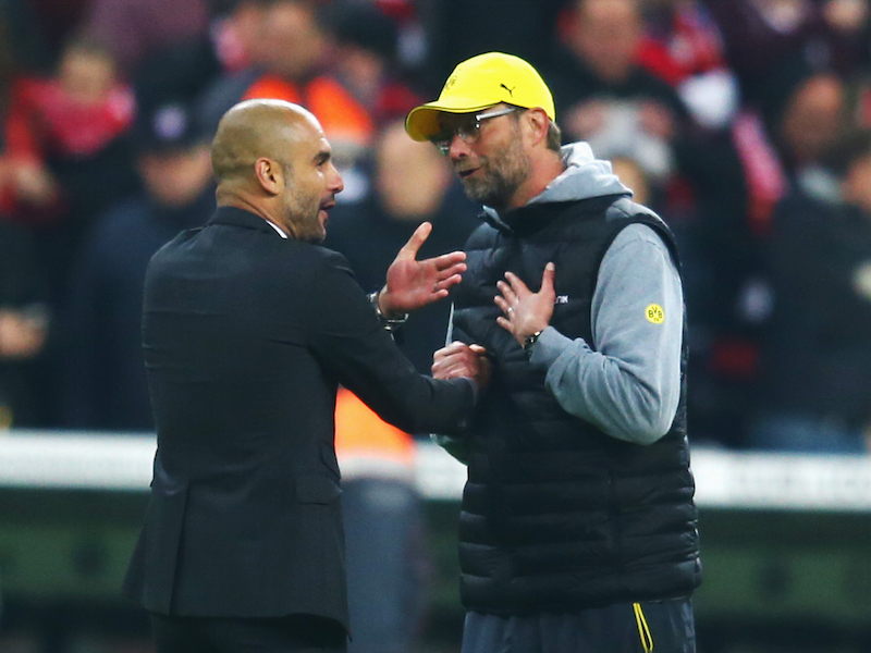 MUNICH, GERMANY - APRIL 28: Head coaches Pep Guardiola of Muenchen and Juergen Klopp of Dortmund discuss during the DFB Cup Semi Final match between FC Bayern Muenchen and Borussia Dortmund at Allianz Arena on April 28, 2015 in Munich, Germany.  (Photo by Alex Grimm/Bongarts/Getty Images)