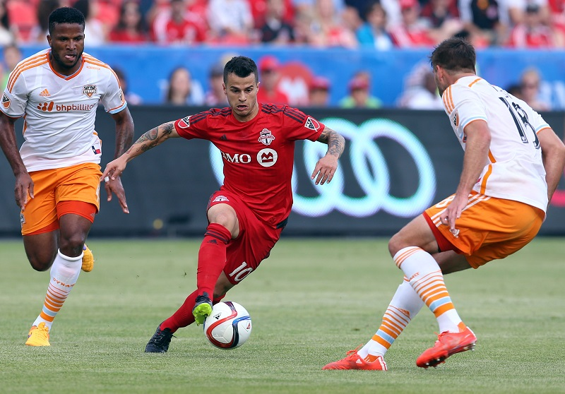 TORONTO, ON - MAY 10:  Sebastian Giovinco #10 of Toronto FC dribbles past David Horst #18 of the Houston Dynamo during an MLS soccer game between the Houston Dynamo and Toronto FC at BMO Field on May 10, 2015 in Toronto, Ontario, Canada.  (Photo by Vaughn Ridley/Getty Images)
