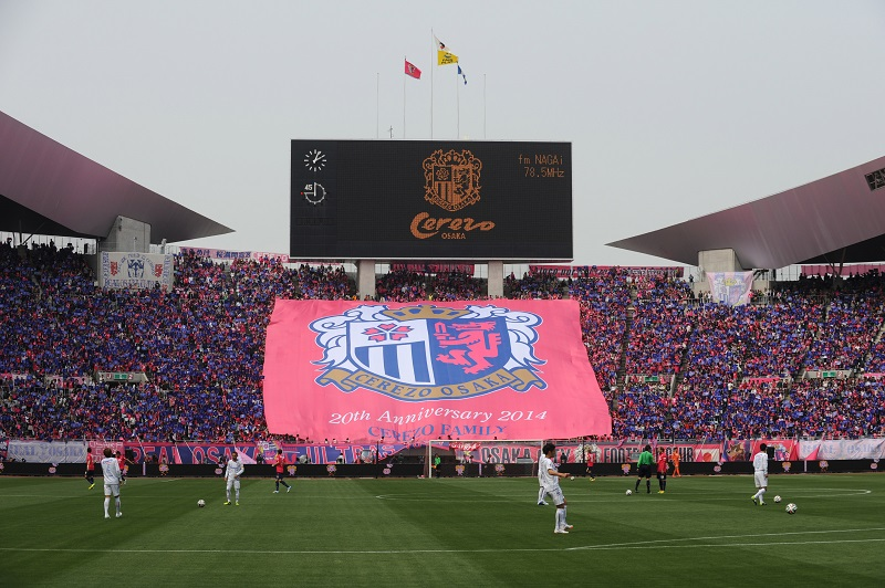 OSAKA, JAPAN - APRIL 12:  (EDITORIAL USE ONLY) Cerezo Osaka supporters hold a big flag prior to the J.League match between Cerezo Osaka and Gamba Osaka at Nagai Stadium on April 12, 2014 in Osaka, Japan.  (Photo by Masashi Hara/Getty Images)