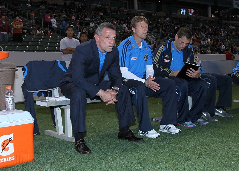 CARSON, CA - APRIL 21:  (L-R) Head Coach Peter Nowak and John Hackworth of Philadelphia Union look on from the bench area prior to their MLS match against Chivas USA at The Home Depot Center on April 21, 2012 in Carson, California. The Union defeated Chivas USA 1-0.  (Photo by Victor Decolongon/Getty Images)