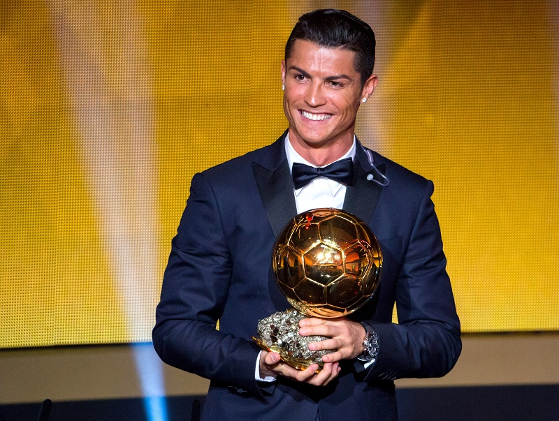 ZURICH, SWITZERLAND - JANUARY 12: Cristiano Ronaldo of Portugal and Real Madrid receives the 2014 FIFA Ballon d'Or award for the player of the year during the FIFA Ballon d'Or Gala 2014 at the Kongresshaus on January 12, 2015 in Zurich, Switzerland. (Photo by Philipp Schmidli/Getty Images)