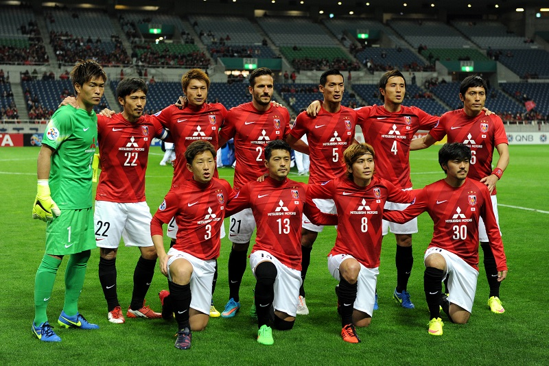 SAITAMA, JAPAN - MARCH 04:  Urawa Red Diamonds players line up for the team photos prior to the AFC Champions League Group G match between Urawa Red Diamonds and Brisbane Roar at Saitama Stadium on March 4, 2015 in Saitama, Japan.  (Photo by Etsuo Hara/Getty Images)