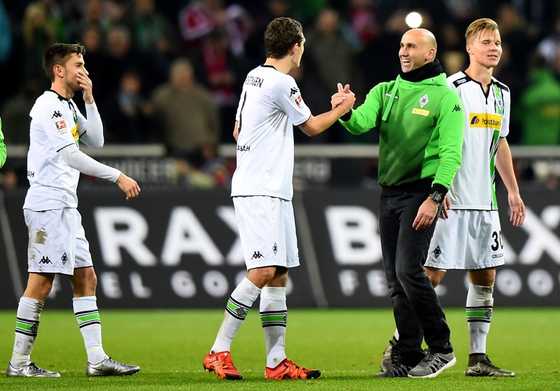MOENCHENGLADBACH, GERMANY - DECEMBER 05: Head coach Andre Schubert of Moenchengladbach celebrates after winning the Bundesliga match between Borussia Moenchengladbach and FC Bayern Muenchen at Borussia-Park on December 5, 2015 in Moenchengladbach, Germany.  (Photo by Lars Baron/Bongarts/Getty Images)