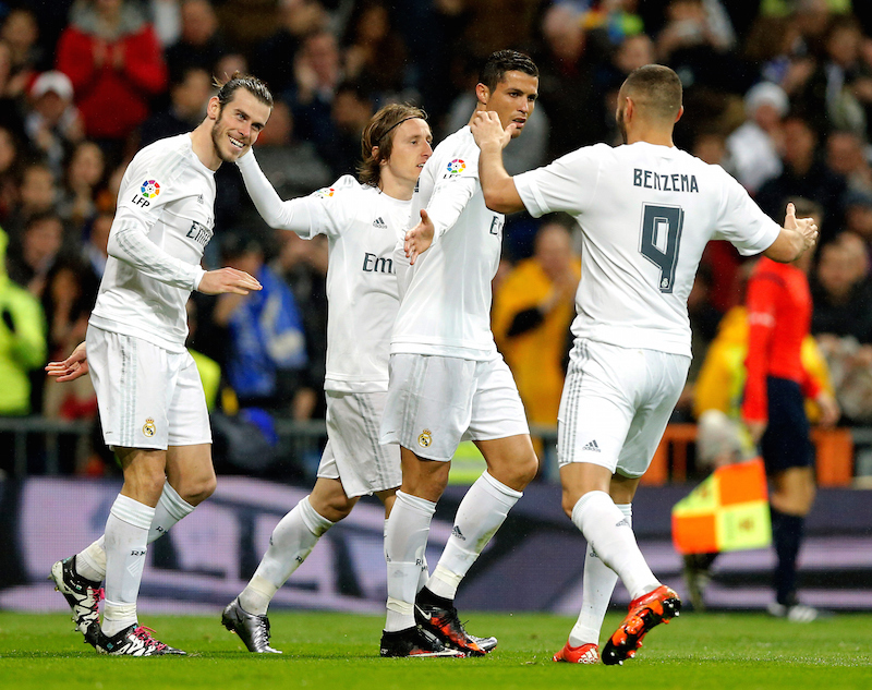 MADRID, SPAIN - JANUARY 09:  Gareth Bale (L) Cristiano Ronaldo (C), Luka Modric and Karim Benzema of Real Madrid celebrate after scoring during the La Liga match between Real Madrid CF and RC Deportivo La Coruna at Estadio Santiago Bernabeu on January 9, 2016 in Madrid, Spain.  (Photo by Helios de la Rubia/Real Madrid via Getty Images)