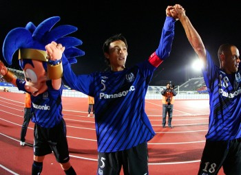 OSAKA, JAPAN - SEPTEMBER 24:  Satoshi Yamaguchi (c) and Roni of Gamba Osaka after celebrate the second goal Asia Champions League quarter final 2nd leg match between Gamba Osaka and Al Karama at Expo '70 Commemorative Stadium on September 24, 2008 in Osaka, Japan. (Photo by Koji Watanabe/Getty Images)
