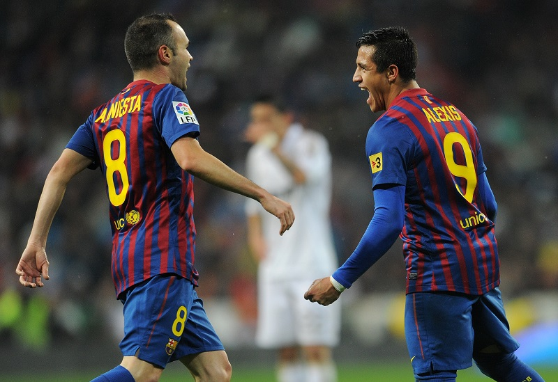 MADRID, SPAIN - DECEMBER 10:  Alexis Sanchez (R) of FC Barcelona celebrates scoring his sides equalizing goal wiith his teammate Andres Iniesta during the la Liga match between Real Madrid and Barcelona at Estadio Santiago Bernabeu on December 10, 2011 in Madrid, Spain.  (Photo by Jasper Juinen/Getty Images)