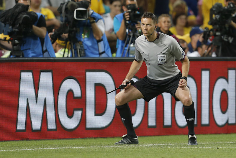 (L-R)  additional assistant referee Pol van Boekel of Holland during the UEFA EURO 2012 match between Ukraine and France at the Donbas Arena on June 15, 2012 in Donetsk, Ukraine. (Photo by VI Images via Getty Images)