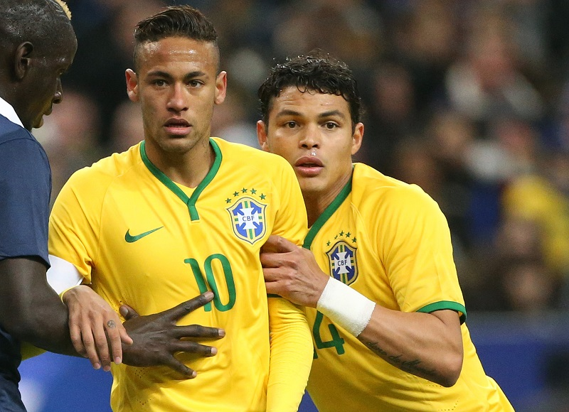 PARIS, FRANCE - MARCH 26: Neymar Jr and Thiago Silva of Brazil in action during the international friendly match between France and Brazil at Stade de France on March 26, 2015 in Saint-Denis near Paris, France. (Photo by Jean Catuffe/Getty Images)