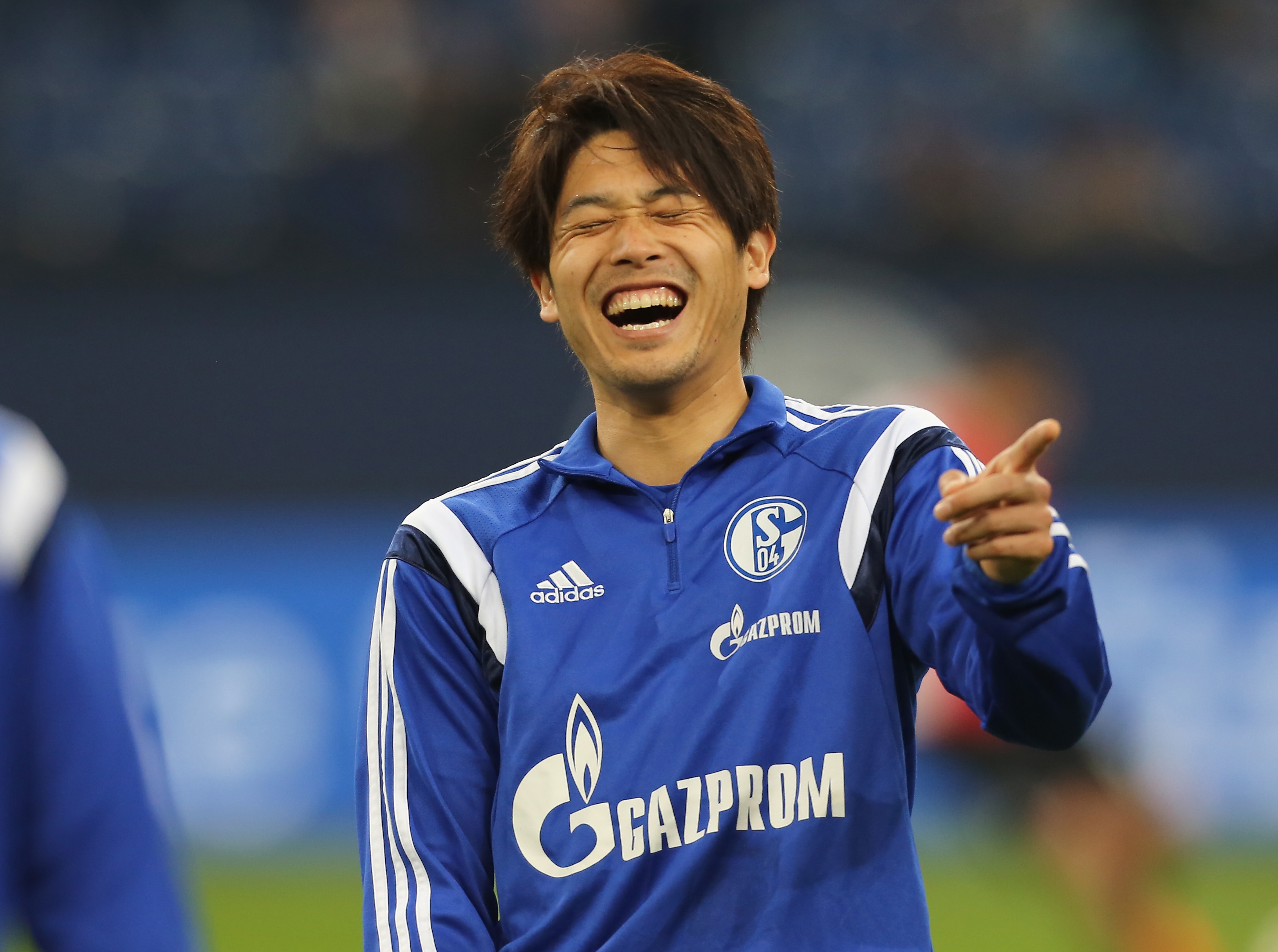 GELSENKIRCHEN, GERMANY - APRIL 11:  Atsuto Uchida of Schalke laughs during the warm-up at the Bundesliga match between Schalke 04 and SC Freiburg at Veltins Arena on April 11, 2015 in Gelsenkirchen, Germany.  (Photo by Juergen Schwarz/Bongarts/Getty Images)