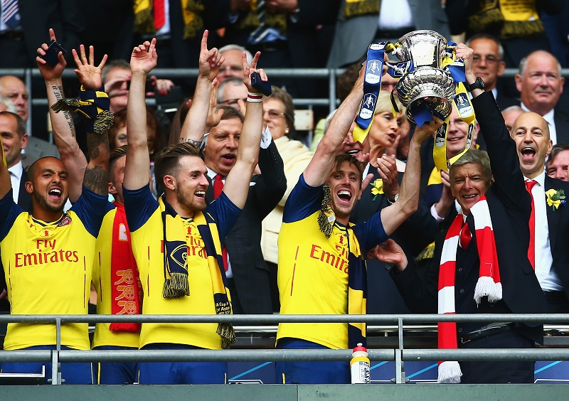 LONDON, ENGLAND - MAY 30:  Arsenal players celebrate with the trophy during the FA Cup Final between Aston Villa and Arsenal at Wembley Stadium on May 30, 2015 in London, England.  (Photo by Jordan Mansfield - The FA/The FA via Getty Images)