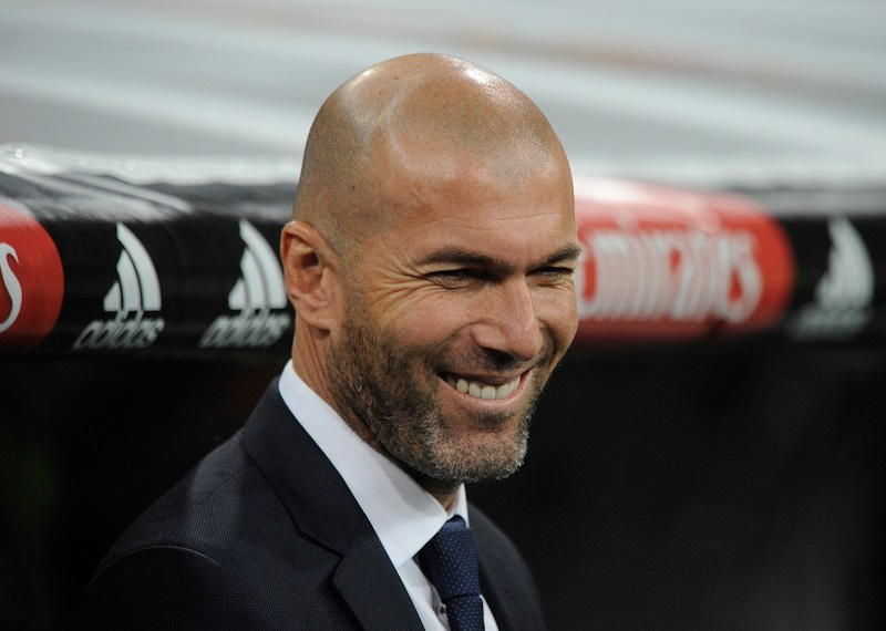 MADRID, SPAIN - JANUARY 31:  Real Madrid manager Zinedine Zidane smiles from the dug-out prior to the start of the La Liga match between Real Madrid CF and Real CD Espanyol at Estadio Santiago Bernabeu on January 31, 2016 in Madrid, Spain.  (Photo by Denis Doyle/Getty Images)