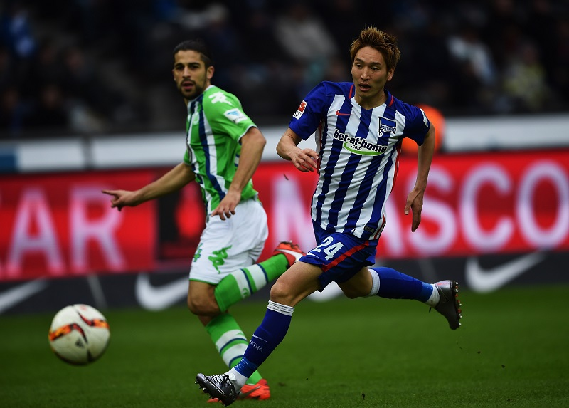 of Wolfsburg is challenged by of Berlin during the Bundesliga match between Hertha BSC and VfL Wolfsburg at Olympiastadion on February 20, 2016 in Berlin, Germany.