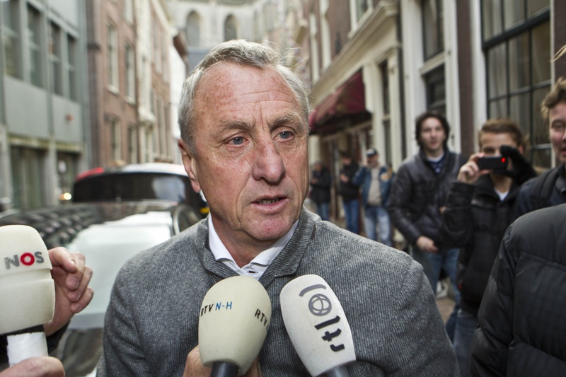 Johan Cruyff is surrounded by reporters as he arrives at court during his legal case to block the appointment of Louis van Gaal as the director of Ajax football club on December 7, 2011 in Haarlem, Netherlands. Cruyff's case is supported by Ajax coaching staff including Marc Overmars and Jaap Stam. (Photo by VI Images via Getty Images)