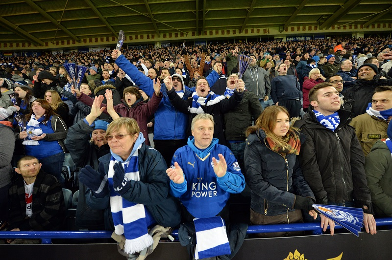 LEICESTER, ENGLAND - FEBRUARY 02 : Leicester City fans celebrate being top of the league after beating Liverpool 2-0 during the Barclays Premier League match between Leicester City and Liverpool at the King Power Stadium on February 02 , 2016 in Leicester, United Kingdom.  (Photo by Plumb Images/Leicester City FC via Getty Images)