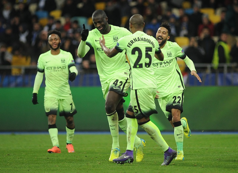 KIEV, UKRAINE - FEBRUARY 24 : Yaya Toure (2nd L), Fernandinho (2nd R) and Gael Clichy (R) celebrate the final goal of Manchester City during the UEFA Champions League Round of 16 soccer match between Dynamo Kyiv and Manchester City at NSC Olimpiyskiy on February 24, 2016 in Kiev, Ukraine. (Photo by Alexey Furman/Anadolu Agency/Getty Images)
