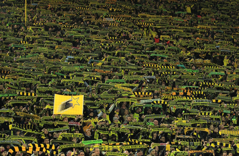 DORTMUND, GERMANY - MARCH 13: Dortmund supporters mourn after a fan passed away during the Bundesliga soccer match between Borussia Dortmund and FSV Mainz 05 at the Signal-Iduna stadium in Dortmund, Germany on March 13, 2016.   (Photo by Leon Kuegeler/Anadolu Agency/Getty Images)