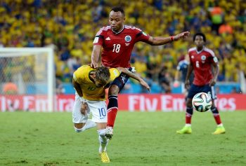 FORTALEZA, BRAZIL - JULY 04: Neymar of Brazil is challenged by Juan Camilo Zuniga of Colombia during the 2014 FIFA World Cup Brazil Quarter Final match between Brazil and Colombia at Castelao on July 4, 2014 in Fortaleza, Brazil.  This tackle resulted in injury to Neymar and ended the player's World Cup. (Photo by Jamie McDonald/Getty Images)