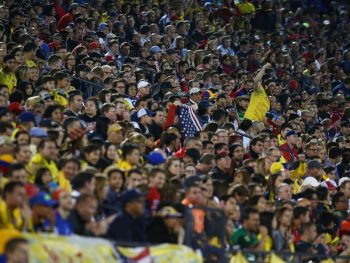 FRISCO, TX - MARCH 29: Fans cheer during the first half of the 2016 CONCACAF Olympic Qualifying playoff between Colombia and the U.S. Under-23 Men's National at Toyota Stadium on March 29, 2016 in Frisco, Texas.  (Photo by Sarah Crabill/Getty Images)
