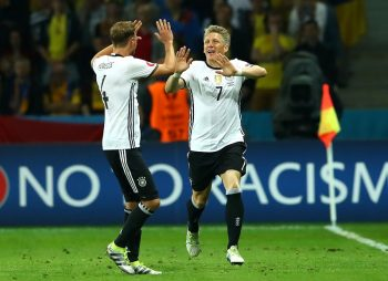 LILLE, FRANCE - JUNE 12: Bastian Schweinsteiger (R) of Germany celebrates scoring his team's second goal with his team mate Benedikt Hoewedes (L) during the UEFA EURO 2016 Group C match between Germany and Ukraine at Stade Pierre-Mauroy on June 12, 2016 in Lille, France.  (Photo by Alexander Hassenstein/Getty Images)