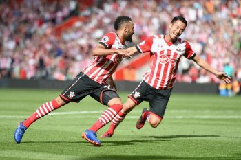 SOUTHAMPTON, ENGLAND - AUGUST 13: Nathan Redmond of Southampton (L) celebrates scoring his sides first goal with team mate Maya Yoshida of Southampton (R) during the Premier League match between Southampton and Watford at St Mary's Stadium on August 13, 2016 in Southampton, England.  (Photo by Tom Dulat/Getty Images)