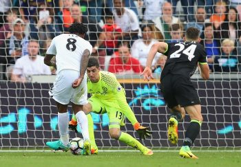 SWANSEA, WALES - SEPTEMBER 11:  Leroy Fer of Swansea City (8) beats goalkeeper Thibaut Courtois and Gary Cahill of Chelsea (24) as he scores their second goal during the Premier League match between Swansea City and Chelsea at Liberty Stadium on September 11, 2016 in Swansea, Wales.  (Photo by Alex Livesey/Getty Images)