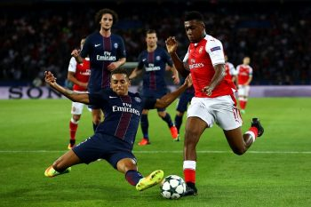 PARIS, FRANCE - SEPTEMBER 13:  Alex Iwobi of Arsenal and Marquinhos of PSG in action during the UEFA Champions League Group A match between Paris Saint-Germain and Arsenal FC at Parc des Princes on September 13, 2016 in Paris, France.  (Photo by Julian Finney/Getty Images)