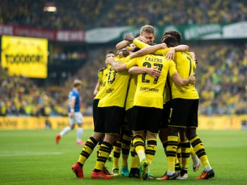 DORTMUND, GERMANY - SEPTEMBER 17: Teammates of Dortmund celebrate the 1:0 goal of Gonzalo Castro (M) of Dortmund during the Bundesliga match between Borussia Dortmund and SV Darmstadt 98 at Signal Iduna Park on September 17, 2016 in Dortmund, Germany. (Photo by Lukas Schulze/Bongarts/Getty Images)