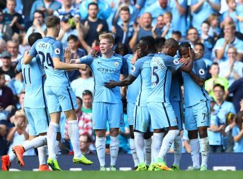 MANCHESTER, ENGLAND - SEPTEMBER 17: Raheem Sterling of Manchester City celebrates scoring his sides third goal with his team mates during the Premier League match between Manchester City and AFC Bournemouth at the Etihad Stadium on September 17, 2016 in Manchester, England.  (Photo by Michael Steele/Getty Images)