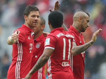 MUNICH, GERMANY - SEPTEMBER 17:  Xabi Alonso (L) of FC Bayen Muenchen celebrates his first goal with teammates Rafinha, Douglas Costa and Arturo Vidal (2ndL-R) during the Bundesliga match between Bayern Muenchen and FC Ingolstadt 04 at Allianz Arena on September 17, 2016 in Munich, Germany.  (Photo by A. Beier/Getty Images for FC Bayern)
