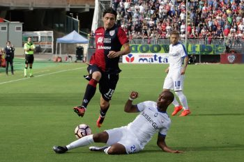 CAGLIARI, ITALY - SEPTEMBER 18: Contrast with Fabio Pisacane of Cagliari and Addoulay Konko of Atalanta  during the Serie A match between Cagliari Calcio and Atalanta BC at Stadio Sant'Elia on September 18, 2016 in Cagliari, Italy.  (Photo by Enrico Locci/Getty Images)