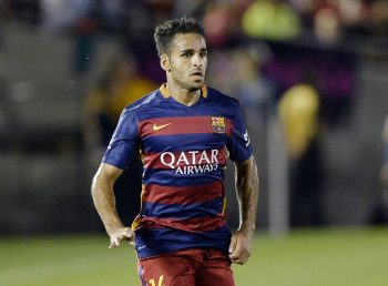 PASADENA, CA - JULY 21: Douglas #16 of FC Barcelona drives the ball during the first half of friendly soccer match against Los Angeles Galaxy in the International Champions Cup at the Rose Bowl July 21, 2015 in Pasadena, California. (Photo by Kevork Djansezian/Getty Images)