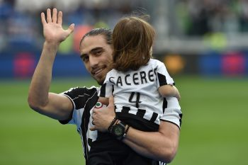 TURIN, ITALY - MAY 14:  Martin Caceres of Juventus FC with his children celebrates after beating UC Sampdoria 5-0 to win the Serie A Championships after the Serie A match between Juventus FC and UC Sampdoria at Juventus Arena on May 14, 2016 in Turin, Italy.  (Photo by Valerio Pennicino/Getty Images)