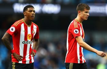 MANCHESTER, ENGLAND - AUGUST 13: Jeremain Lens (L) of Sunderland and (R) Paddy McNair of Sunderland are dejected after the final whistle during the Premier League match between Manchester City and Sunderland at Etihad Stadium on August 13, 2016 in Manchester, England.  (Photo by Michael Steele/Getty Images)