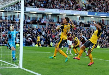 BURNLEY, ENGLAND - OCTOBER 02:  (L) Laurent Koscielny defelcts (R) Alex Oxlade-Chambelrain's shot to score the Arsenal goal during the Premier League match between Burnley and Arsenal at Turf Moor on October 2, 2016 in Burnley, England.  (Photo by Stuart MacFarlane/Arsenal FC via Getty Images)