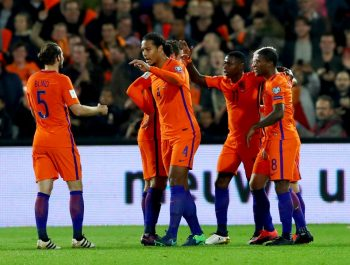 ROTTERDAM, NETHERLANDS - OCTOBER 07:  Quincy Promes #11 of the Netherlands celebrates scoring his teams second goal of the game with team mates during the FIFA 2018 World Cup Qualifier between Netherlands and Belarus held at De Kuip on October 7, 2016 in Rotterdam, Netherlands.  (Photo by Dean Mouhtaropoulos/Getty Images)