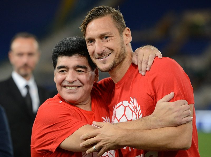 Francesco Totti  and  Diego Maradona during the match for the peace - Uniti per la Pace at the Olympic Stadium in Rome, on october 12, 2016. (Photo by Silvia Lore/NurPhoto via Getty Images)