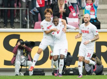 COLOGNE, GERMANY - OCTOBER 15: Anthony Modeste of Koeln (M) celebrates his first goal with teammates Yuya Osako of Koeln (L) and Konstantin Rausch of Koeln (R) during the Bundesliga match between 1. FC Koeln and FC Ingolstadt 04 at RheinEnergieStadion on October 15, 2016 in Cologne, Germany. (Photo by Lukas Schulze/Bongarts/Getty Images)