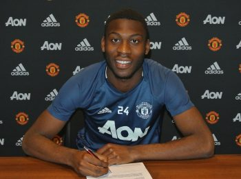MANCHESTER, ENGLAND - OCTOBER 19:  (EXCLUSIVE COVERAGE)  Timothy Fosu-Mensah of Manchester United signs a new contract at Aon Training Complex on October 19, 2016 in Manchester, England.  (Photo by Manchester United/Man Utd via Getty Images)