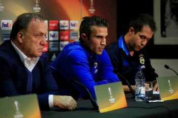 MANCHESTER, UNITED KINGDOM - OCTOBER 19: Fenerbahce's Head Coach Dick Advocaat (L) and Fenerbahce's striker Robin van Persie (C)  hold a press conference at the Old Trafford stadium in Manchester,  United Kingdom on October 19 2016. ahead of their UEFA Europa League Group stage soccer match against Manchester United. (Photo by Lindsey Parnaby/Anadolu Agency/Getty Images)