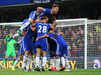 LONDON, ENGLAND - OCTOBER 23: Gary Cahill of Chelsea jumps on tops as N'golo Kante of Chelsea celebrates with his team mates after he scores to make it 4-0 during the Premier League match between Chelsea and Manchester United at Stamford Bridge on October 23, 2016 in London, England. (Photo by Catherine Ivill - AMA/Getty Images)