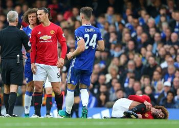 LONDON, ENGLAND - OCTOBER 23: David Luiz of Chelsea and Zlatan Ibrahimovic of Manchester United have words with Referee Martin Atkinson as Marouane Fellaini of Manchester United lies injured during the Premier League match between Chelsea and Manchester United at Stamford Bridge on October 23, 2016 in London, England. (Photo by Catherine Ivill - AMA/Getty Images)