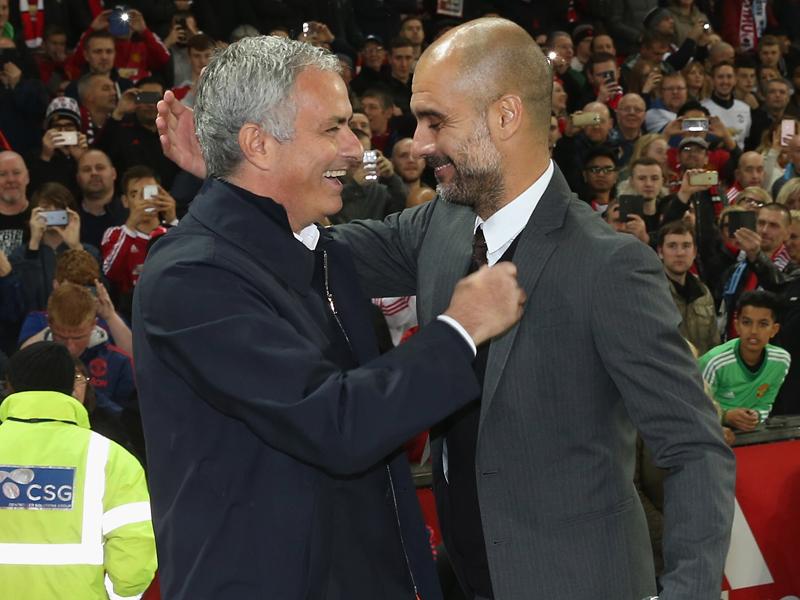 試合前、笑顔の両指揮官 [写真]=Man Utd via Getty Images