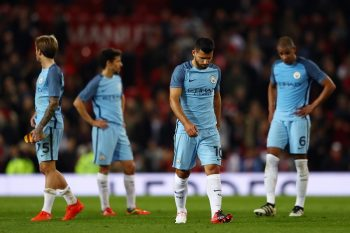 MANCHESTER, ENGLAND - OCTOBER 26: Sergio Aguero of Manchester City (C) and his Manchester City team mates show dejection after the final whistle during the EFL Cup fourth round match between Manchester United and Manchester City at Old Trafford on October 26, 2016 in Manchester, England.  (Photo by Michael Steele/Getty Images)